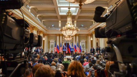 """Overall view shows media attending a joint press conference by US President Donald Trump (L) and Russia's President Vladimir Putin after a meeting at the Presidential Palace in Helsinki, on July 16, 2018. The US and Russian leaders opened an historic summit in Helsinki, with Donald Trump promising an """"extraordinary relationship"""" and Vladimir Putin saying it was high time to thrash out disputes around the world.  / AFP PHOTO / Lehtikuva / Yuri KADOBNOV"""