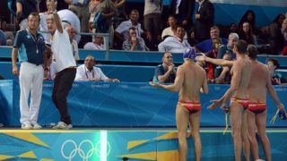 Spain's head coach Rafael Aguilar Morillo (2nd L) gestures to referee Boris Margeta (L) of Slovenia after losing to Croatia in their men's water polo preliminary match of the London 2012 Olympic Games at Water Polo Arena in London on July 31, 2012. Croatia beat Spain 8-7.  AFP PHOTO/ MANAN VATSYAYANA / AFP PHOTO / MANAN VATSYAYANA