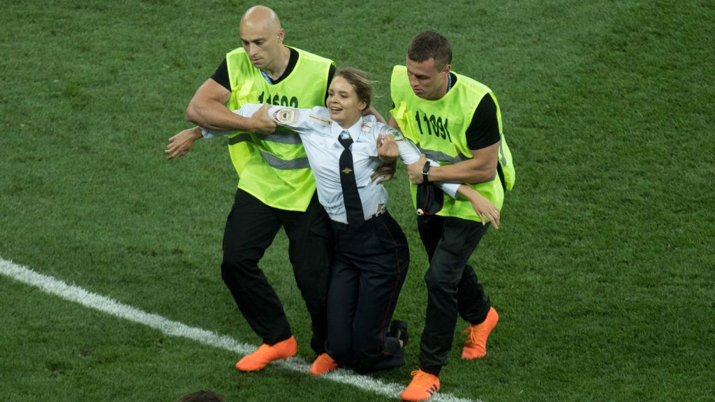 """A female member of the Russian """"Pussy Riot"""" activist group stormed the field and was carried away, racer, protest, disturbance, disturbance, France (FRA) - Croatia (CRO) 4: 2, final, game 64, on 15.07. 2018 in Moscow; Football World Cup 2018 in Russia from 14.06. - 15.07.2018. 