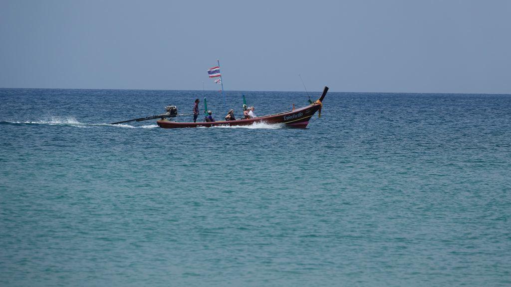 12 March 2018, Thailand, Karon Beach: A longboat sailing on the Andaman Sea off Karon Beach on the island of Phuket. Photo: Alexandra Schuler/dpa