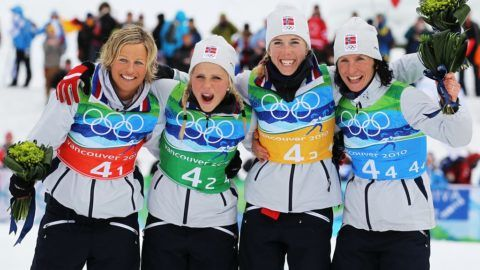 WHISTLER, BC - FEBRUARY 25: (L-R) Vibeke W Skofterud, Therese Johaug, Kristin Stoermer Steira and Marit Bjoergen of Norway celebrate after winning the gold medal during the Ladies' Cross Country 4x5 km Relay on day 14 of the 2010 Vancouver Winter Olympics at Whistler Olympic Park Cross-Country Stadium on February 25, 2010 in Whistler, Canada.   Al Bello/Getty Images/AFP