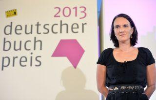 FRANKFURT AM MAIN, GERMANY - OCTOBER 07:  Novelist Terezia Mora wins the German book prize 2013 (Deutscher Buchpreis 2013) on October 7, 2013 at city hall 'Roemer' in Frankfurt am Main, Germany. The nominees for the shortlist are Mirko Bonne ('Nie mehr Nacht'), Reinhard Jirgl ('Nichts von euch auf Erden'), Clemens Meyer ('Im Stein'), Terézia Mora ('Das Ungeheuer'), Marion Poschmann ('Die Sonnenposition') and Monika Zeiner ('Die Ordnung der Sterne'). The German Book Prize is presented to the best German-language novel just before the start of the Frankfurt Book Fair as an annual award from the Boersenverein des Deutschen Buchhandels Stiftung (the Foundation of the German Publishers and Booksellers Association)  (Photo by Thomas Lohnes/Getty Images)