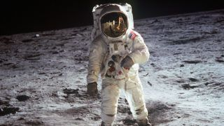 """UNSPECIFIED  :  1st steps of human on Moon : american astronaut Edwin """"Buzz"""" Aldrin walking on the moon on july 20, 1969 during Apollo 11 mission (we see Neil Armstrong in the visor of the helmet)  (Photo by Apic/Getty Images)"""