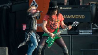 DONINGTON, ENGLAND - JUNE 09: Axl Rose and Slash of Guns N Roses perform onstage on Day 2 of the Download Festival at Donington Park on June 9, 2018 in Donington, England. (Photo by Ollie Millington/Getty Images )