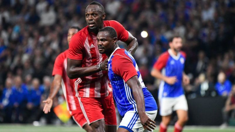 Fifa 98's Usain Bolt reatcs during an exhibition football match between France's 1998 World Cup's French football national team and FIFA 98 composed with former international players, to mark the 20th anniversary of France's 1998 World Cup victory, on June 12, 2018 at the U Arena in Nanterre, near Paris. (Photo by Julien Mattia/NurPhoto via Getty Images)