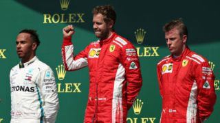 NORTHAMPTON, ENGLAND - JULY 08:  Top three finishers Sebastian Vettel of Germany and Ferrari, Lewis Hamilton of Great Britain and Mercedes GP and Kimi Raikkonen of Finland and Ferrari celebrate on the podium during the Formula One Grand Prix of Great Britain at Silverstone on July 8, 2018 in Northampton, England.  (Photo by Charles Coates/Getty Images)