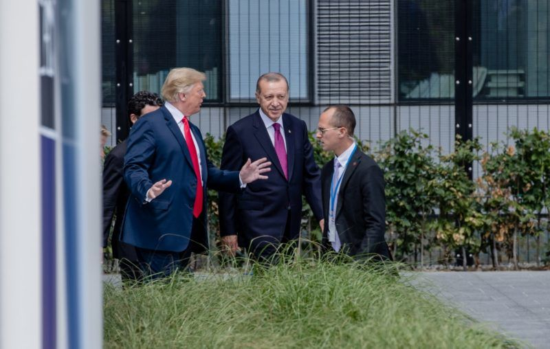 U.S. President Donald Trump, left, walks with Recep Tayyip Erdogan, Turkey's president, ahead of a family photo gathering at the North Atlantic Treaty Organization (NATO) summit, at the military and political alliance's headquarters in Brussels, Belgium, on Wednesday, July 11, 2018. President Donald Trump opened up another front in his tussle with allies on his arrival at NATOs annual summit, targeting Germany over its support for the Nord Stream 2 gas pipeline from Russia. Photographer: Marlene Awaad/Bloomberg via Getty Images