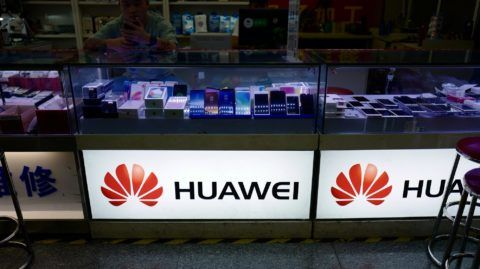 The Huawei logo is seen in a shop in Shanghai on May 3, 2018. Top US and Chinese officials prepared on May 3 to kick off crucial trade talks in Beijing but both sides sought to dampen expectations for a quick resolution to a heated dispute between the world's two largest economies. / AFP PHOTO / Johannes EISELE