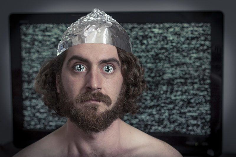 Brain washed crazy man is hypnotized by television program