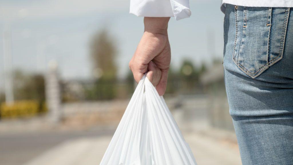 Woman holding a plastic bag