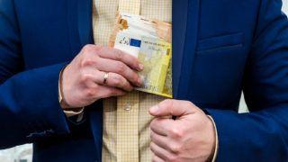 A businessman takes a bribe in euros.