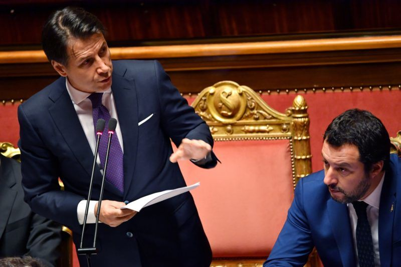 Italy's newly sworn-in Prime Minister Giuseppe Conte (L) addresses senators flanked by Italy's Interior Minister and Deputy Prime Minister Matteo Salvini (R) during a debate ahead of a confidence vote in the Italian Senate in Rome on June 5, 2018. Italy's populist coalition will test its power on June 5 in the first of this week's two parliamentary confidence votes in the new government. The first eurosceptic government in a founding EU nation was sworn in on June 1 after almost three months of political turmoil that raised concern across Europe and sparked weeks of volatility on financial markets.  / AFP PHOTO / Andreas SOLARO