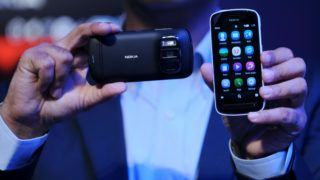 Director and head of smart devices, Nokia India Vipul Mehrotra displays the newly launched Nokia 808 Pureview smart phone at a function in New Delhi on June 13, 2012.   Nokia India unveiled its much awaited Nokia 808 pureview with 41MP sensor and the most advanced imaging innovation. The Nokia 808 pureview costs INR 33,899 (610 USD).  AFP PHOTO/ SAJJAD HUSSAIN / AFP PHOTO / SAJJAD HUSSAIN