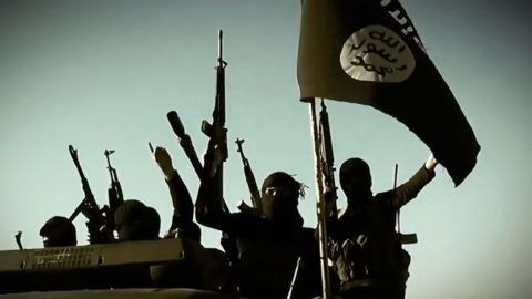 """An image grab taken from a propaganda video released on March 17, 2014 by the Islamic State of Iraq and the Levant (ISIL)'s al-Furqan Media allegedly shows ISIL fighters raising their weapons as they stand on a vehicle mounted with the trademark Jihadists flag at an undisclosed location in the Anbar province. The jihadist Islamic State of Iraq and the Levant group has spearheaded a major offensive that began on June 9, 2014 and has since overrun all of Iraq's northern Nineveh province. AFP PHOTO / HO / AL-FURQAN MEDIA === RESTRICTED TO EDITORIAL USE - MANDATORY CREDIT """"AFP PHOTO / HO / AL-FURQAN MEDIA"""" - NO MARKETING NO ADVERTISING CAMPAIGNS - DISTRIBUTED AS A SERVICE TO CLIENTS FROM ALTERNATIVE SOURCES, AFP IS NOT RESPONSIBLE FOR ANY DIGITAL ALTERATIONS TO THE PICTURE'S EDITORIAL CONTENT, DATE AND LOCATION WHICH CANNOT BE INDEPENDENTLY VERIFIED === / AFP PHOTO / AL-FURQAN MEDIA / - / RESTRICTED TO EDITORIAL USE - MANDATORY CREDIT """"AFP PHOTO / HO / AL-FURQAN MEDIA"""" - NO MARKETING NO ADVERTISING CAMPAIGNS - DISTRIBUTED AS A SERVICE TO CLIENTS FROM ALTERNATIVE SOURCES, AFP IS NOT RESPONSIBLE FOR ANY DIGITAL ALTERATIONS TO THE PICTURE'S ED"""