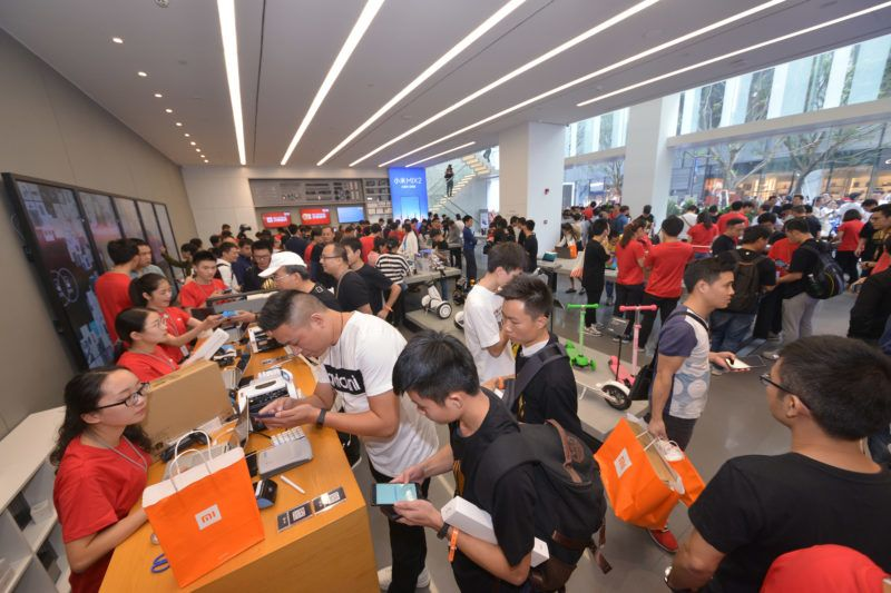 Customers try out smartphones and electronic devices at the world's first flagship Mi Home of Xiaomi in Shenzhen city, south China's Guangdong province, 5 November 2017.  Earlier this year, Xiaomi set a target to open at least 200 Mi Stores globally and in recent times, we have seen Mi stores in new areas like Malaysia, Thailand, and Greece.The Chinese company performed the grand opening of its upgraded flagship Mi Store at Shenzhen on the 5th of November. This Store was the very first Mi Home and its grand upgrade is expected to catapult Xiaomi to a new retail milestone. However, Xiaomi president, Zhang Jianhui said that before the grand opening of this Store, 7 new Mi stores will be opened this week at Shaoxing, Yinchuan, Zhongshan, Tianjin, Lianyungang, Shiyan, and Dongying. This will act as a warm-up towards the main November 15 opening. Interestingly, Mi Home records daily sales up to 260,000 Yuan, this is only second to Apples 400,000 Yuan and larger than luxury brand Tiffany's 200,000 Yuan.