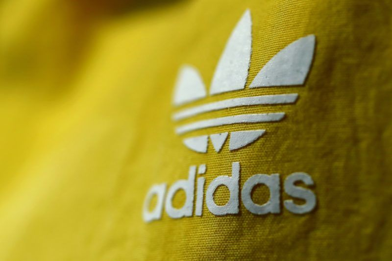 14 March 2018, Germany, Herzogenaurach: The adidas logo on an item of clothing at the annual results press conference of adidas AG. Photo: Daniel Karmann/dpa