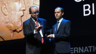 Kurdish mathematician, Caucher Birkar (R), 40, receives the Fields Medal Award, math's most prestigious prize, during the International Congress of Mathematicians (ICM 2018) in Rio de Janeiro, Brazil, on August 01, 2018.  The Kurdish refugee is Cambridge University professor and today had the gold medal stolen from him just minutes later, organizers said. Caucher Birkar, 40, was one of four winners of the Fields award, which is seen as equivalent to the Nobel prize in mathematics. Crime-ridden Rio was the first Latin American city to host the prize-giving ceremony.  / AFP PHOTO / STR