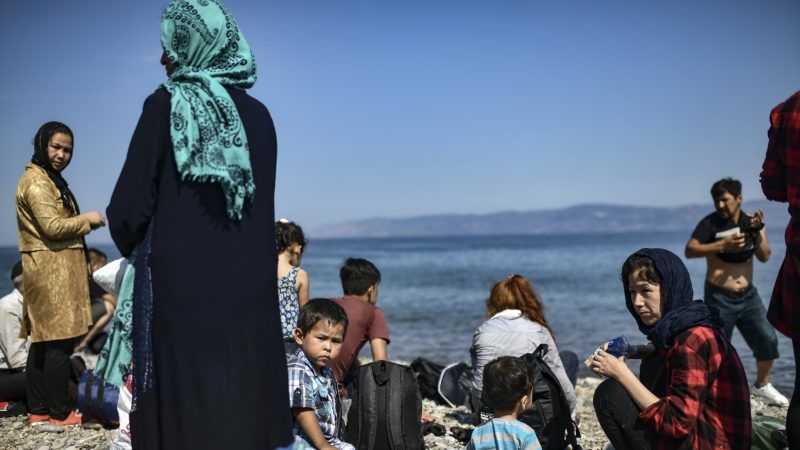 Migrants from Afghanistan arrive after crossing the Aegean Sea from Turkey with a dinghy on the Greek Mediterranean island of Lesbos on August 6, 2018. More than 1,500 refugees and migrants have died trying to cross the Mediterranean Sea to Europe in the first seven months of this year, over half of them in June and July, the UN refugee agency said on August 3, 2018. / AFP PHOTO / Aris MESSINIS