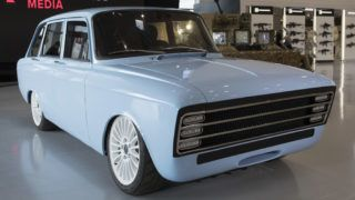 """A handout picture taken on August 22, 2018 and released by Kalashnikov media press office,  shows a retro-looking pale blue prototype electric car, the CV-1,  produced by Russian arms maker Kalashnikov, in Moscow. Russian arms maker Kalashnikov presented, on August 23, 2018, its new electric car inspired by a rare 1970s model, saying the new technology will rival Elon Musk's Tesla. The brand, best known for the AK-47 machine gun, presented the decidedly retro-looking pale blue prototype, the CV-1, at a defence expo outside Moscow. Kalashnikov Concern has long been trying to expand its brand, recently launching lines of clothing and other civilian merchandise ranging from umbrellas to mobile phone covers.  / AFP PHOTO / KALASHNIKOV MEDIA / HO / RESTRICTED TO EDITORIAL USE - MANDATORY CREDIT """"AFP PHOTO / HO / Kalashnikov media"""" - NO MARKETING NO ADVERTISING CAMPAIGNS - DISTRIBUTED AS A SERVICE TO CLIENTS"""
