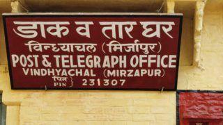 India, Uttar Pradesh, man near post office.