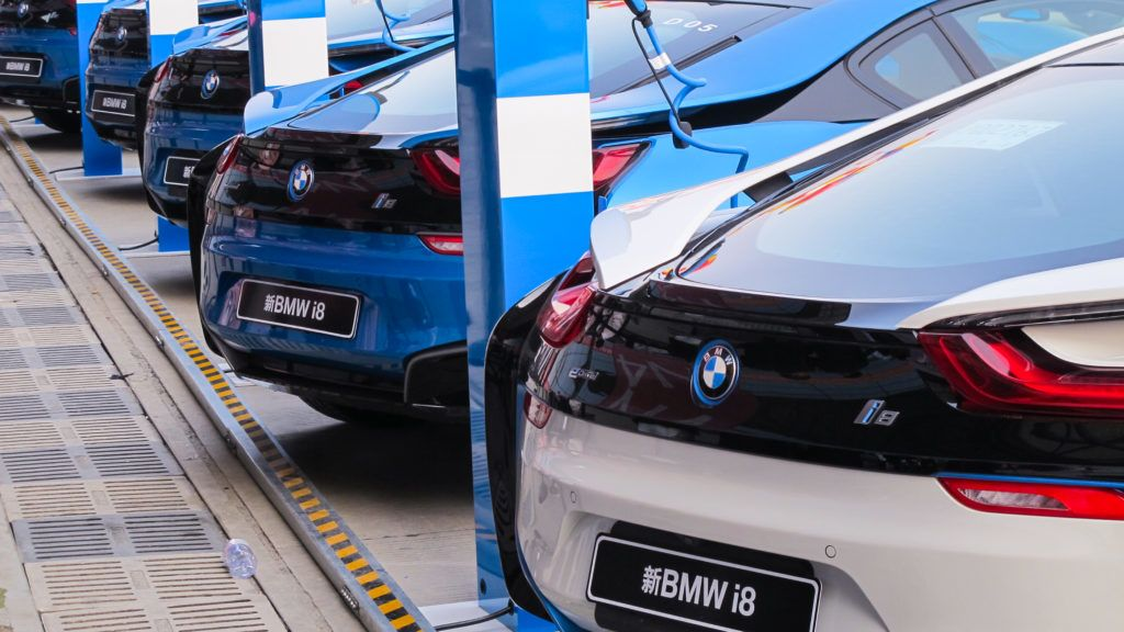 --FILE--Electric vehicles of BMW i8 are being recharged at a BMW's charging station in Shanghai, China, 11 May 2016.  German carmaker BMW said it will raise the prices of two US-made crossover sport utility vehicles (SUV) in China to cope with the additional cost of tariffs on US car imports into the world's biggest auto market. In a move due to take effect on Monday (30 July 2018), BMW said in a statement to Reuters over the weekend that it will increase suggested retail prices of the popular, relatively high-margin X5 and X6 SUV models by 4 percent to 7 percent. The rates of increase suggest that BMW is willing to absorb much of the higher costs stemming from bringing the SUVs to China from its factory in South Carolina, underscoring the fierce competition among luxury car brands in China. BMW's move comes after China imposed new tariffs earlier this month on about $34 billion of US imports, from soybeans and cars to lobsters, as part of a widening trade row. China, which this year cut tariffs on all imported automobiles, slapped an additional 25 percent levy on US-made cars as of July 6. As a result, China now levies a 40 percent import duty on all cars imported from the US.