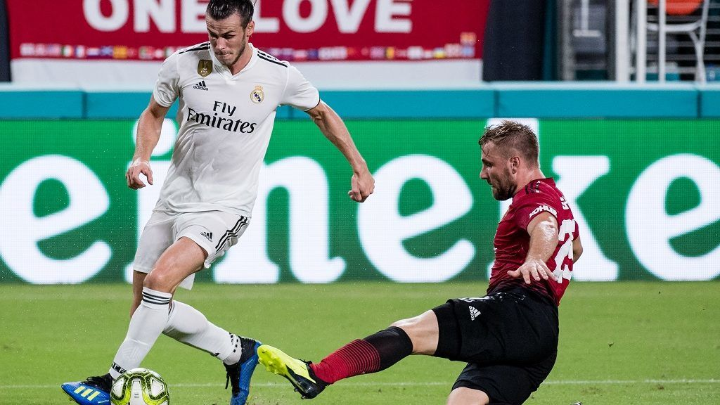 MIAMI, FL - JULY 31: Gareth Bale #11 of Real Madrid in action past Luke Shaw #23 of Manchester United during the International Champions Cup match at Hard Rock Stadium on July 31, 2018 in Miami, Florida.   Rob Foldy/Getty Images/AFP