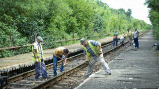 Workers are seen repairing train tracks in Neptun, Romania on July 24, 2018. (Photo by Jaap Arriens/NurPhoto)