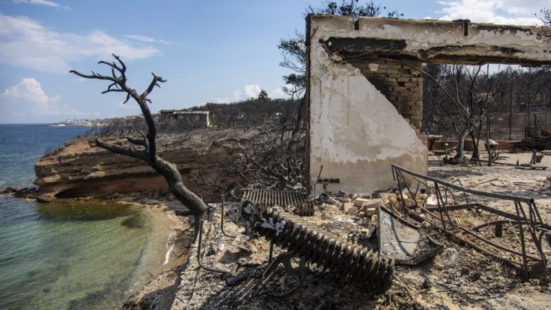 Pictures from the wider area of Mati and Neos Voutsas in eastern Attica near Athens after the fire. The fire that took place on 23 of July 2018 was one of the worsts in the century. The death count has been raised to 88 victims. Many people are still missing and the research is still going on. The area is still without electricity. The first count was that 2500 houses have been destroyed. July 28, 2018 - Mati, Attica, Greece (Photo by Nicolas Economou/NurPhoto)