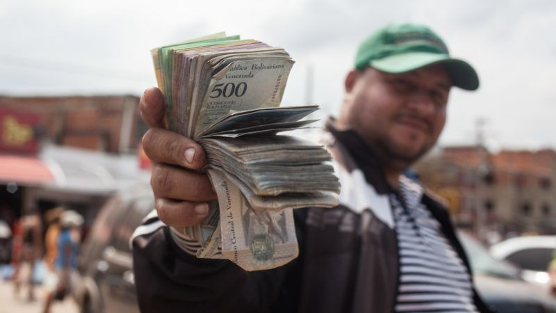 Venezuela's economy on the collapse, You can't get $1 out of the bank in Venezuela. Some of them tried, Now they just try to do something with this devalued currency, This is a typical day in the Colombian-Venezuelan border, In most of the world, getting a little money out of the bank is an errand, something forgettable. In Venezuela, for millions of people, it is complicated, tedious and surreal, or just impossible. in Cucuta, Colombia on June 10, 2018.  (Photo by Juan Torres/NurPhoto)