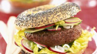 hamburger in poppy seed bagel