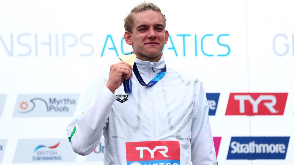 GLASGOW, SCOTLAND - AUGUST 12:  Kristof Rasovszky of Hungary celebrates victory with his Gold Medal following the Men's 25km Open Water Swimming Race on Day eleven of the European Championships Glasgow 2018 at Loch Lomond on August 12, 2018 in Glasgow, Scotland.  This event forms part of the first multi-sport European Championships.  (Photo by Clive Rose/Getty Images)