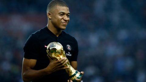 Paris Saint-Germain's French forward Kylian Mbappe poses and holds the 2018 World Cup Trophy prior to the French L1 football match between Paris Saint-Germain and Caen on August 12, 2018 at the Parc des Princes, in Paris. (Photo by Mehdi Taamallah/NurPhoto via Getty Images)