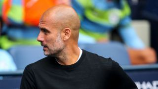 MANCHESTER, ENGLAND - AUGUST 19: Pep Guardiola the head coach / manager of Manchester City during the Premier League match between Manchester City and Huddersfield Town at Etihad Stadium on August 19, 2018 in Manchester, United Kingdom. (Photo by Robbie Jay Barratt - AMA/Getty Images)