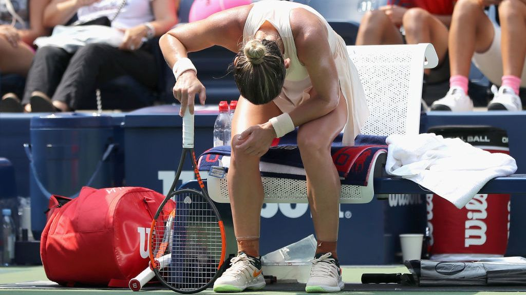 NEW YORK, NY - AUGUST 27:  Simona Halep of Romania reacts in her women's singles first round match against Kaia Kanepi of Estonia on Day One of the 2018 US Open at the USTA Billie Jean King National Tennis Center on August 27, 2017 in the Flushing neighborhood of the Queens borough of New York City.  (Photo by Elsa/Getty Images)