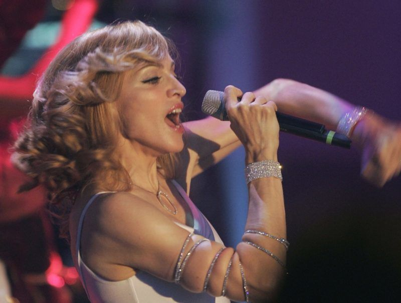 """MANNHEIM, GERMANY - NOVEMBER 05:  U.S. singer Madonna performs during the live broadcast of """"Wetten, dass..?"""" on ZDF television at the Maimarkthalle November 5, 2005 in Mannheim, Germany.   (Photo by Ralph Orlowski/Getty Images)"""