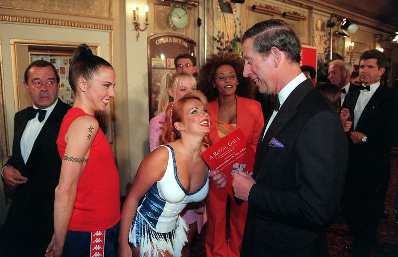 The Prince of Wales gets a warm reception from the Spice girls, as he jokes with Geri Halliwell at the Princes Trust concert, Manchester on May 9th, 1997. (Photo by Anwar Hussein/WireImage)