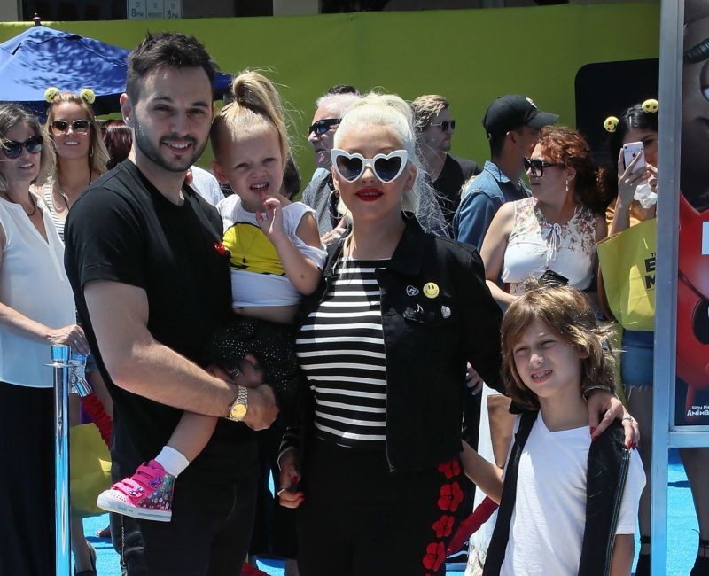 """WESTWOOD, CA - JULY 23:  (L-R) Guitarist Matthew Rutler, daughter Summer Rain Rutler, wife singer Christina Aguilera and her son Max Liron Bratman attend the premiere of Columbia Pictures and Sony Pictures Animation's """"The Emoji Movie"""" at the Regency Village Theatre on July 23, 2017 in Westwood, California.  (Photo by David Livingston/Getty Images)"""