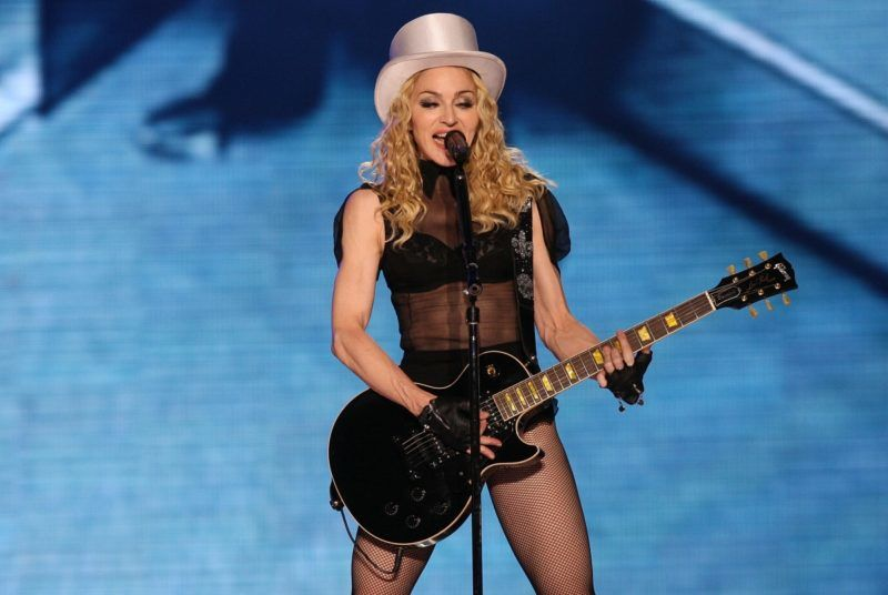 """MEXICO CITY - NOVEMBER 29:  Singer Madonna performs during the """"Sticky & Sweet"""" tour at Foro Sol on November 29, 2008 in Mexico City.  (Photo by Victor Chavez/WireImage)"""
