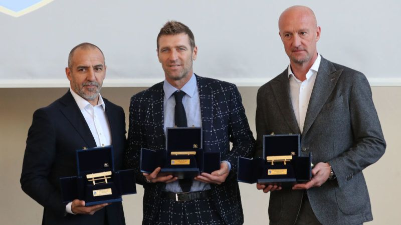 """FLORENCE, ITALY - MARCH 26: Roberto Bordin, Massimo Carreca and Marco Rossi receive the """"Golden Bench"""" award for coaches who have won abroad during the Italian Football Federation 'Panchine D'Oro E D'Argento' Prize at Coverciano on March 26, 2018 in Florence, Italy.  (Photo by Gabriele Maltinti/Getty Images)"""