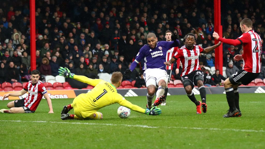 BRENTFORD, ENGLAND - MARCH 30:  Leon Clarke of Sheffield United has his shot saved by Daniel Bentley of Brentford during the Sky Bet Championship match between Brentford and Sheffield United at Griffin Park on March 30, 2018 in Brentford, England.  (Photo by Julian Finney/Getty Images)