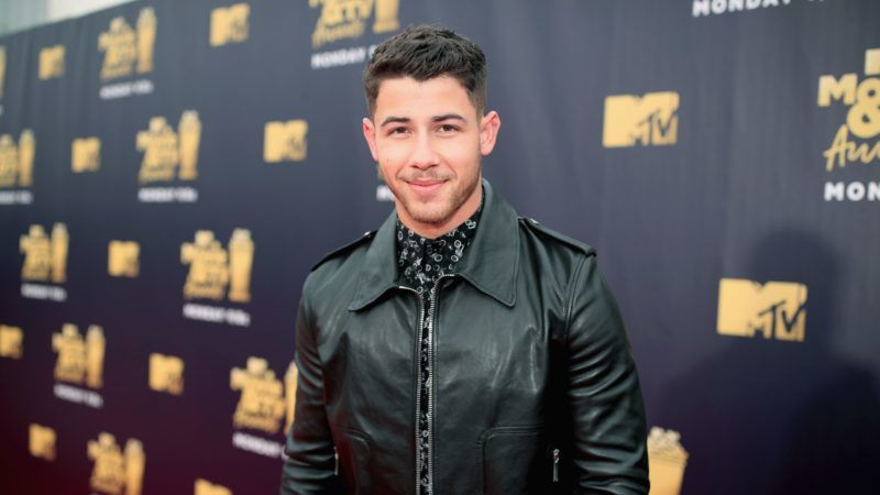 SANTA MONICA, CA - JUNE 16:  Singer Nick Jonas attends the 2018 MTV Movie And TV Awards at Barker Hangar on June 16, 2018 in Santa Monica, California.  (Photo by Christopher Polk/Getty Images for MTV)
