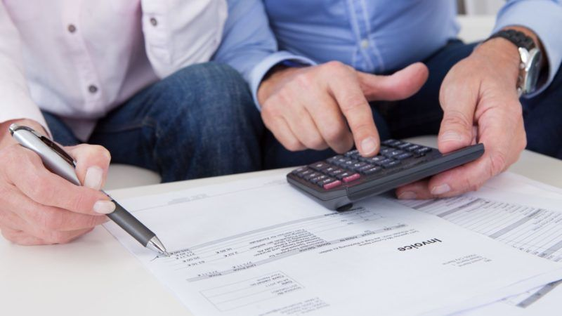 Close-up of mature couple doing finances at home
