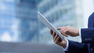 Hands of a businessman holding digital tablet