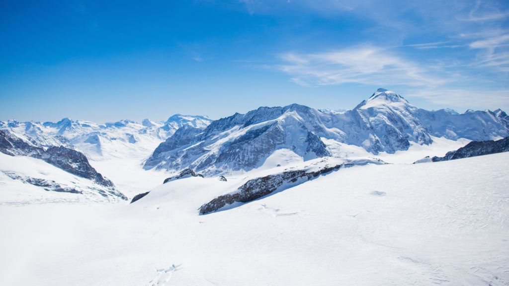 Aerial view of the Alps mountains in Switzerland. View from helicopter in Swiss Alps. Mountain tops in snow. Breathtaking view of Jungfraujoch and the UNESCO World Heritage â?? the Aletsch Glacier