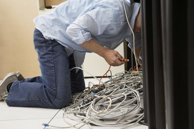 Man Working on Computer Hardware