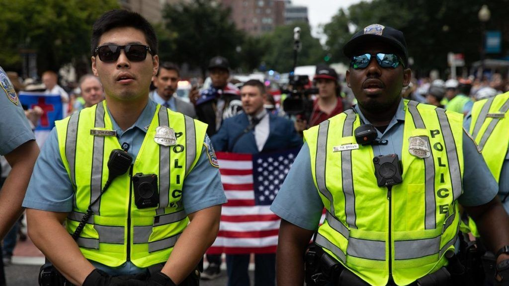 """WASHINGTON, USA - AUGUST 12: Security officials stand guard as right wing extremists stage a demonstration, named """"Unite The Right 2"""" rally, for the one-year anniversary of the deadly far-right protests, which costed a young woman's life in Charlottesville, as they march to the Lafayette Square in Washington, United States on August 12, 2018. Yasin Ozturk / Anadolu Agency"""
