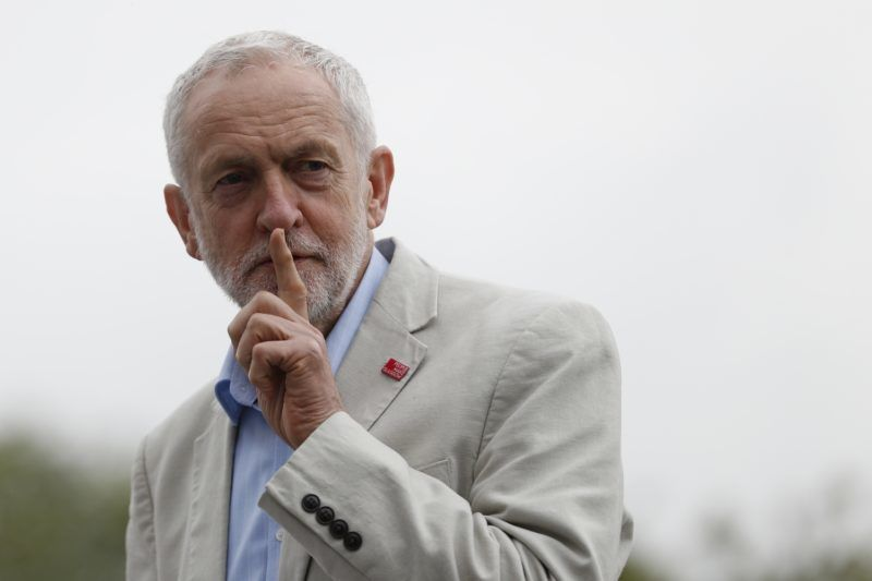 Britain's main opposition Labour Party leader Jeremy Corbyn gestures to the crowd not to cheer him before he takes the stage to speak during a rally organised by the Trades Union Congress (TUC) calling for a new deal for working people in central London on May 12, 2018. The TUC called for a national demonstration on May 12 to demand an end to the government's austerity policies and better rights for all in the workplace.  / AFP PHOTO / Adrian DENNIS