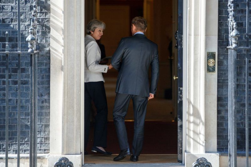 Britain's Prime Minister Theresa May (L) reacts as she talks with European Council President Donald Tusk after posing for photographs outside of 10 Downing Street in central London on June 25, 2018, ahead of their meeting. / AFP PHOTO / Tolga AKMEN