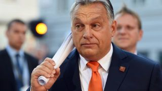 Hungary's Prime Minister Viktor Orban arrives at the Mozarteum University to attend a plenary session part of the EU Informal Summit of Heads of State or Government in Salzburg, Austria, on September 20, 2018. / AFP PHOTO / Christof STACHE