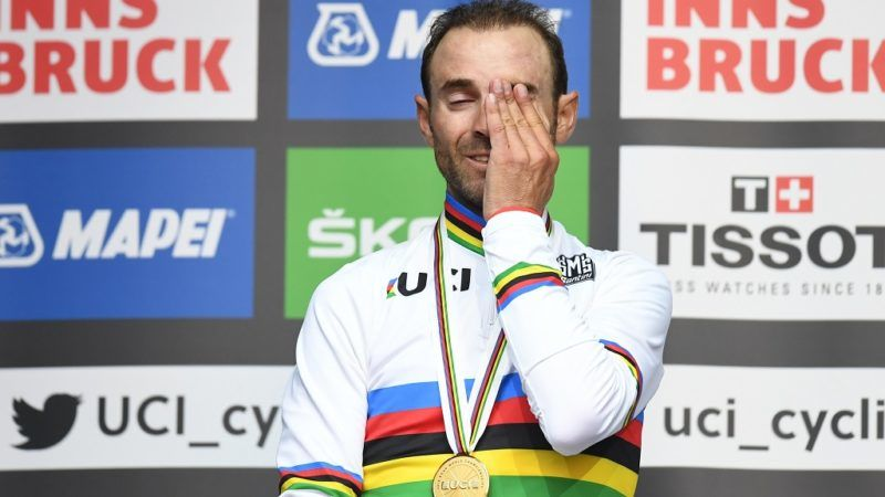Spanish cyclist Alejandro Valverde reacts on the podium during the winner ceremony of the Men's Elite road race of the 2018 UCI Road World Championships in Innsbruck, Austria on September 30, 2018.  / AFP PHOTO / Christof STACHE